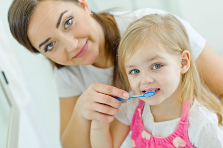 Mom and Daughter brushing their teeth - Pediatric Dentist in Lake Jackson, TX