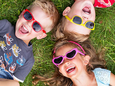 Kids in the grass - Pediatric Dentist in Lake Jackson, TX
